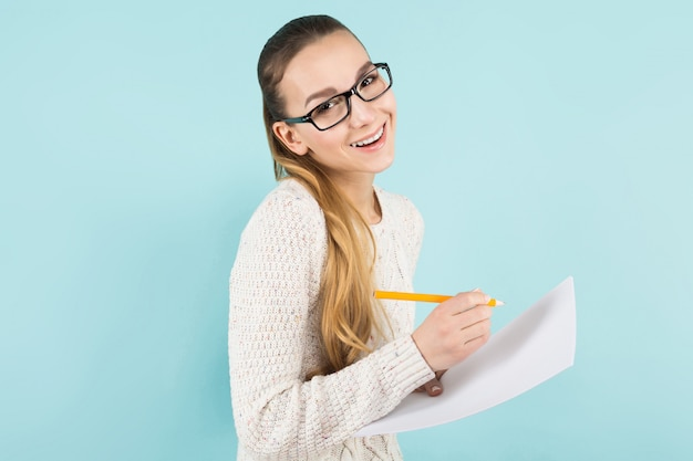 Attractive woman with ponytail and paper sheet