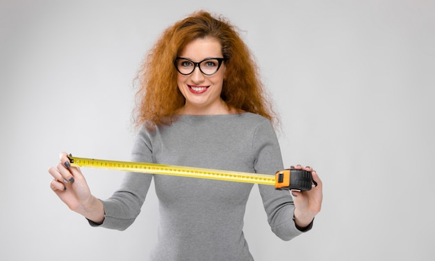 Attractive woman with ruler