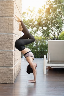 Attractive women are playing yoga. at the pool for her good health