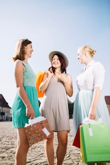 Attractive women laughing on suburban street