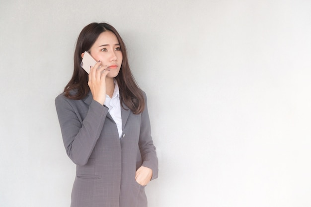 Attractive young asian businesswoman making a phone call.