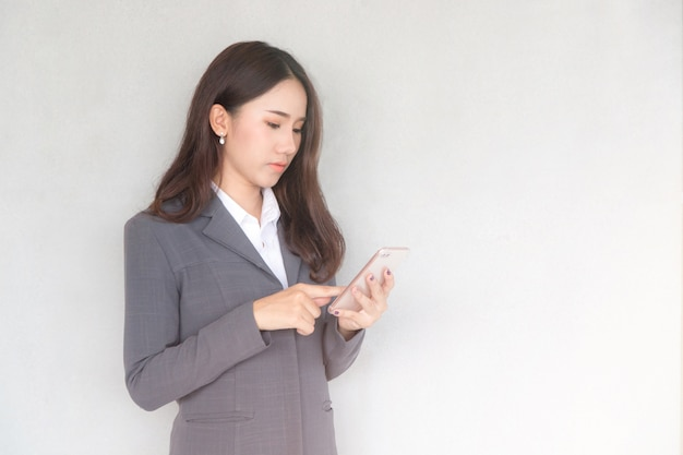 Attractive young asian businesswoman using a smartphone.