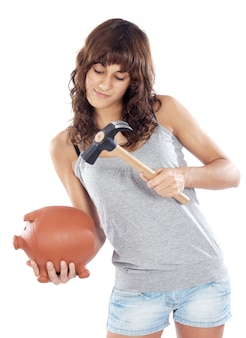Attractive young casual girl with money box a over white background
