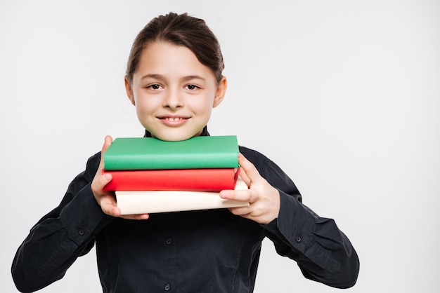 Attractive young girl holding books