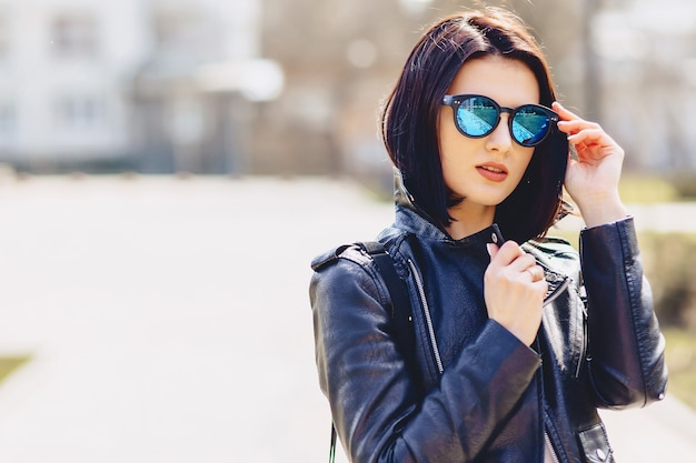 Attractive young girl in sunglasses on sunny day