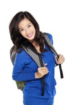 バッグと魅力的な若い幸せな学生