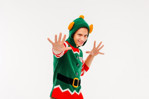 Attractive young men in elf costume on white background