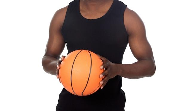 バスケットボールのボールを持つ魅力的な若い人以上の白い背景