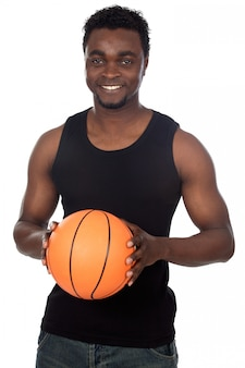 Attractive young person with basketball ball a over white background