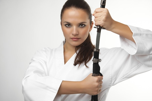 Attractive young sexy women with samurai sword