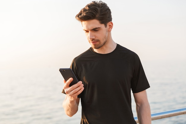 Attractive young sportsman in black t-shirt
