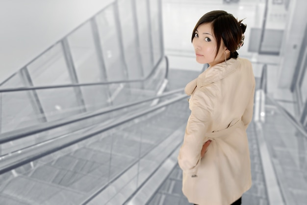 Attractive young woman of asian inside of modern building.