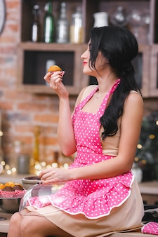 Attractive young woman baking in the kitchen