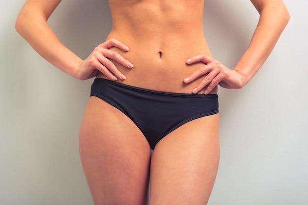Attractive young woman in black underwear.