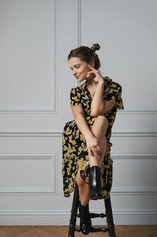 Attractive young woman dressed in floral dress
