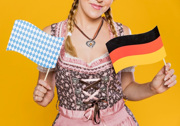 Attractive young woman holding flags