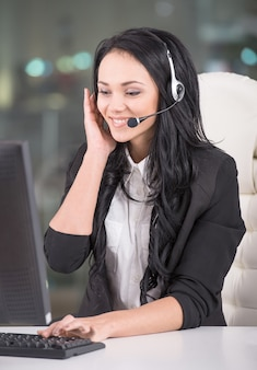 Attractive young woman is working in a call center.