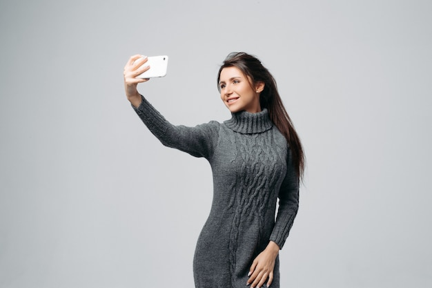 Attractive young woman taking selfie