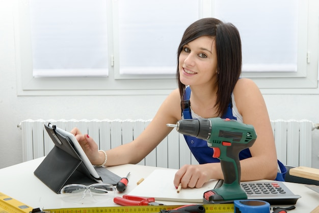 Attractive young woman using the tablet for diy