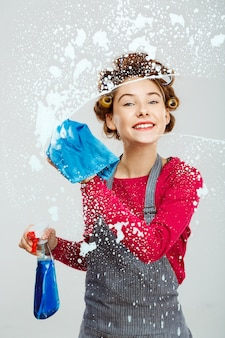Attractive young woman washes windows
