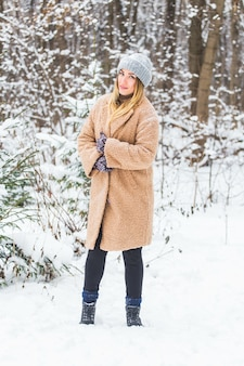 Attractive young woman in winter time outdoor
