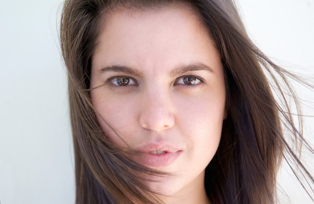 Attractive young woman with hair blowing int he wind