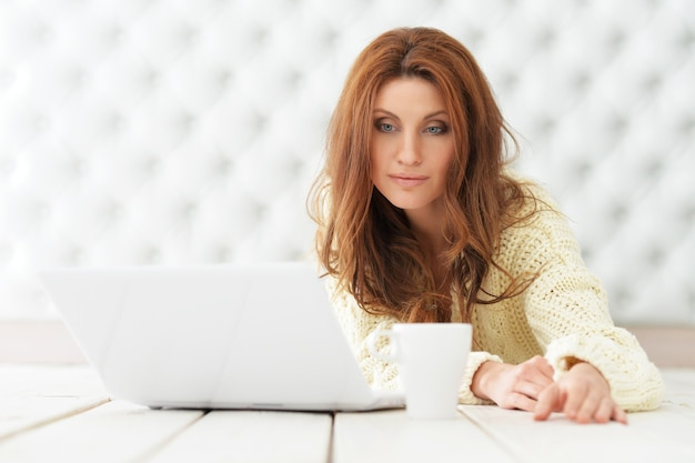 Attractive young woman with laptop at home