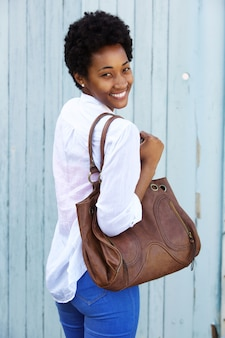 Attractive young woman with a purse