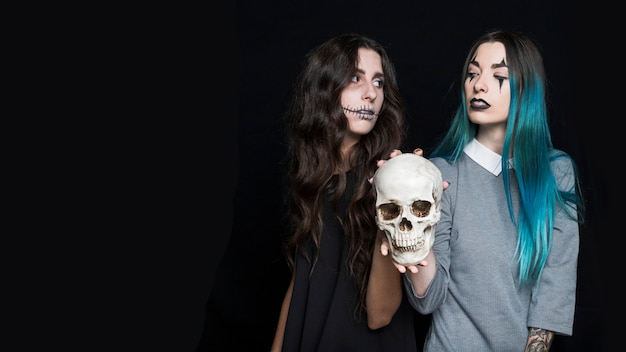 Attractive young womenwith skull
