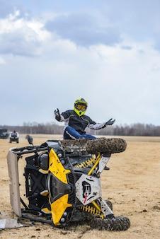 Atv utv overturned, the rider sits near the broken all-terrain vehicle