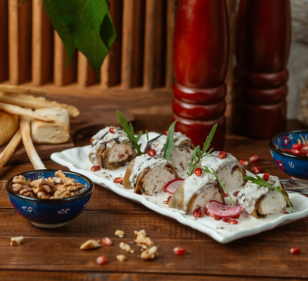 Aubergine wraps with cream cheese and walnut
