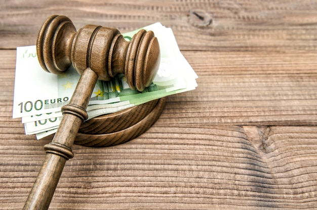 Auctioneer hammer judges gavel euro banknotes