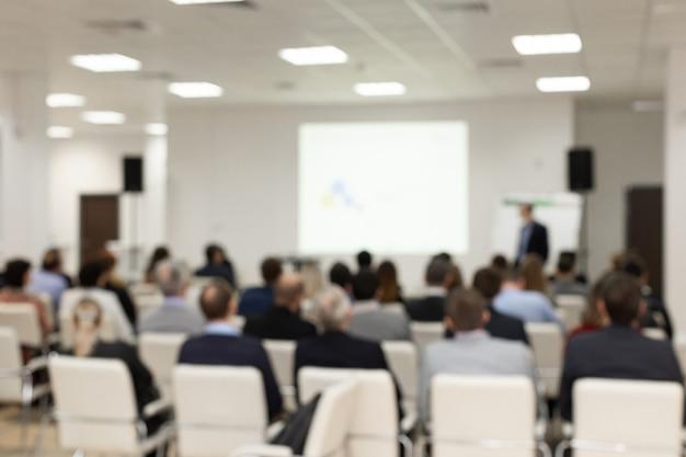 会議室の聴衆。ぼやけた画像ぼやけた写真。 。ビジネスと起業家精神のコンセプト。