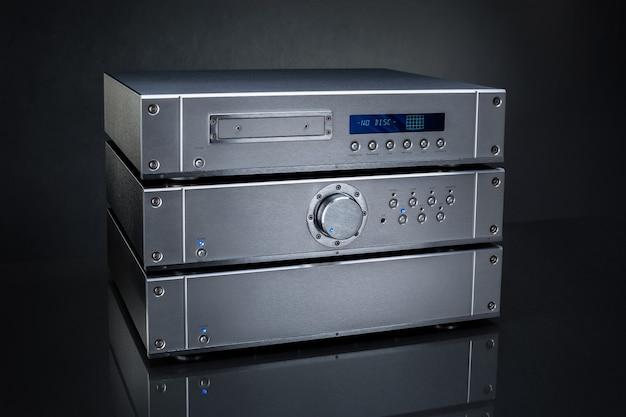 Audio amplifier on a black background, close-up. Premium Photo