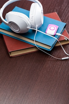 Audio books  with old book and headphones