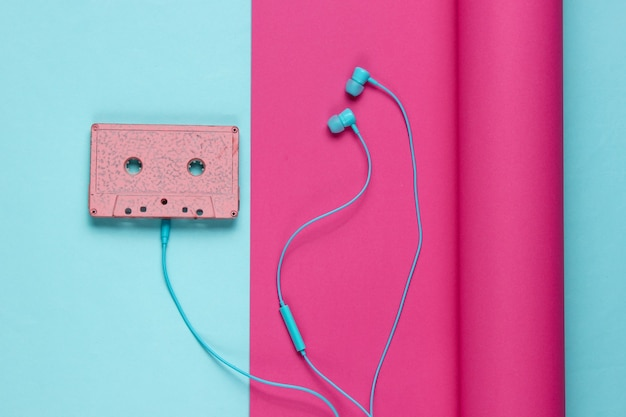 Audio cassette and earphones on wrapped paper