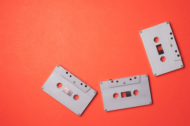 Audio cassette tapes on a orange background. free space for text