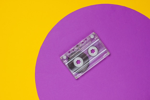 Audio cassette on yellow with purple circle