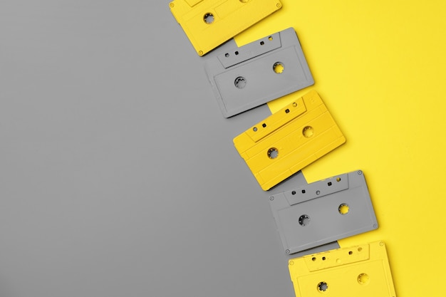 Audio cassettes on gray and yellow background