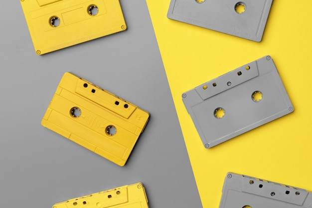 Audio cassettes on gray and yellow