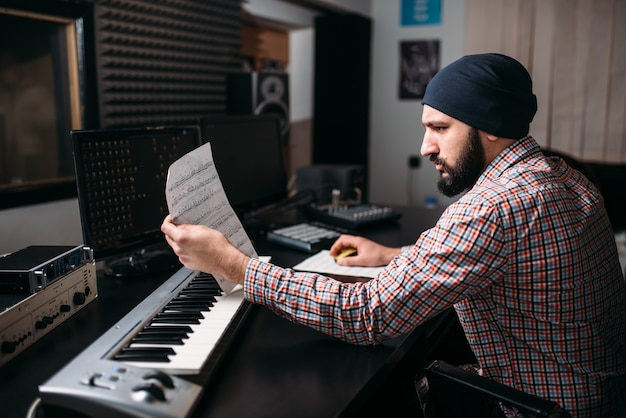 Audio engineering, sound producer work with synthesizer in studio. professional digital media technology