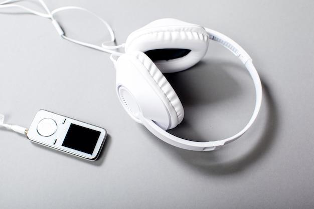 Audio headphones with cord on grey background