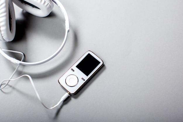 Audio headphones with cord on grey