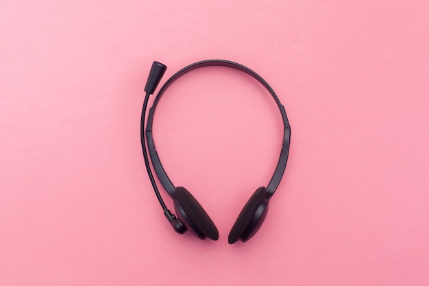 Audio headset on color background