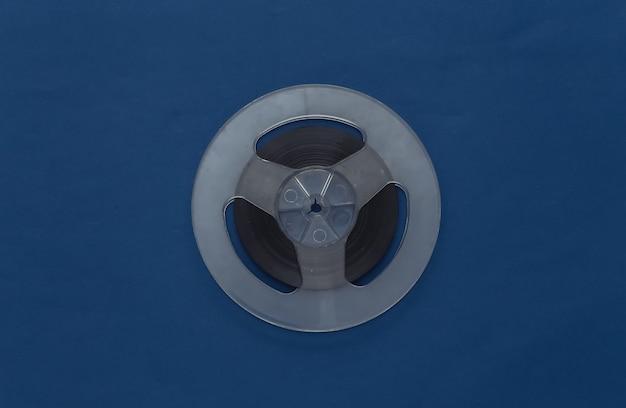 Audio magnetic tape. film reel on classic blue. retro style