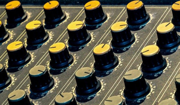 Audio sound mixer console. sound mixing desk. music mixer control panel in recording studio. audio mixing console with faders and adjusting knob. sound engineer. sound mixer control radio broadcasting