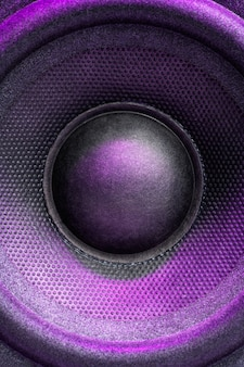 Audio speaker or music column with purple backlight, close up. vertical photo