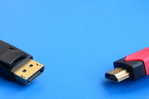 Audio video hdmi computer cable plug and 20-pin male displayport gold plated connector for a flawless connection on a blue background