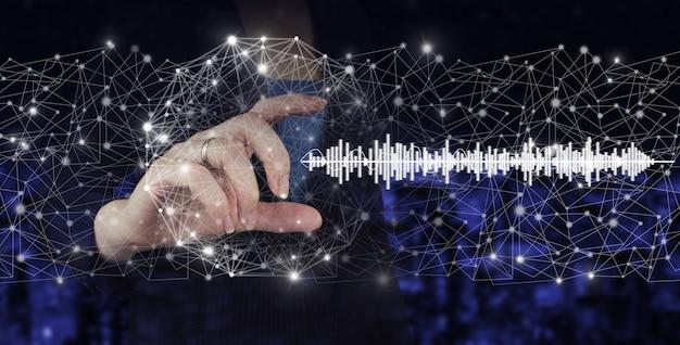 Audiobook audio technology. digital sound track on hand. hand hold digital hologram sound track, wave sign on city dark blurred background.