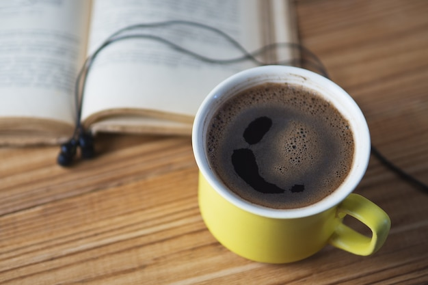 Audiobook concept and a cup of coffee
